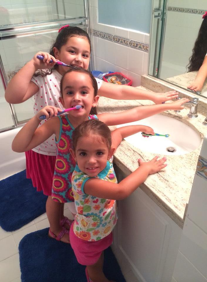 Girls Brushing Teeth With Faucet Off