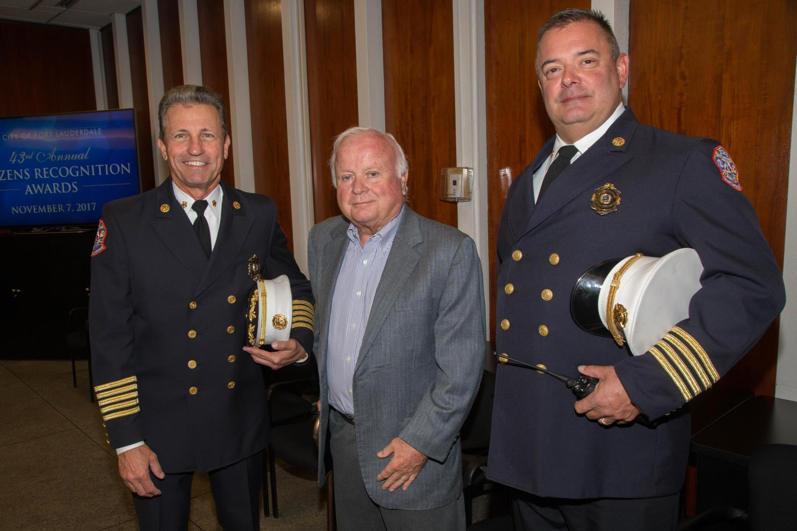 Fire Chief Robert Hoercherl, Former Commissioner John Aurelius, and Deputy Fire Chief Timothy Heiser