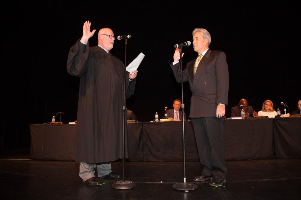 U.S. District Judge John K. Olson swears into office Commissioner Glassman at the Parker Playhouse ceremony.