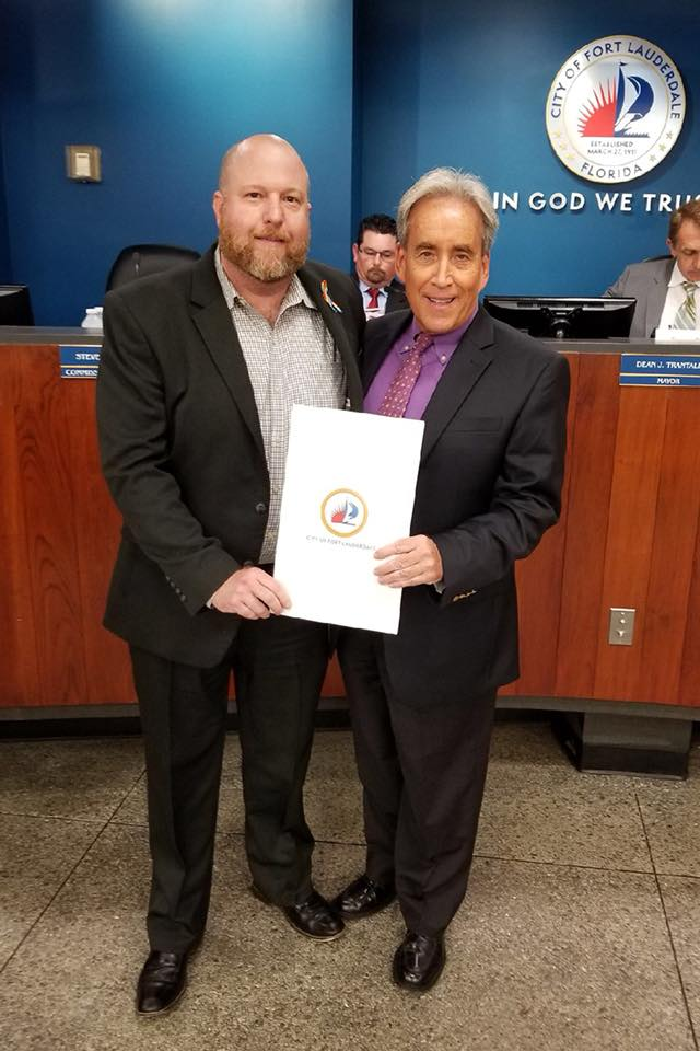 City Proclamation in recognition of Pride Month presented to Chris Rudisill.