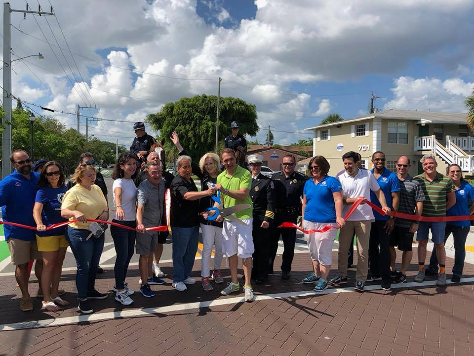 Community leaders cutting the ribbon for the Old Dixie Highway Complete Streets Ceremony.