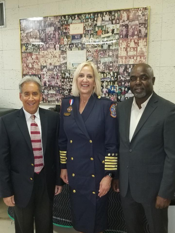 Swearing in Ceremony for Fire Chief Rhoda Mae Kerr with Commissioners Glassman and McKinzie.